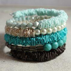 Handmade memory wire bracelet made of ruffled satin ribbon and beads. Beaded bracelet in teal, brown, cream, jade. Fabric bracelet. $55.00, via Etsy.