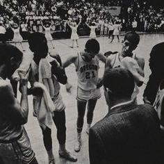 Oregon basketball players during a timeout 1964. From the 1964 Oregana (University of Oregon yearbook). www.CampusAttic.com
