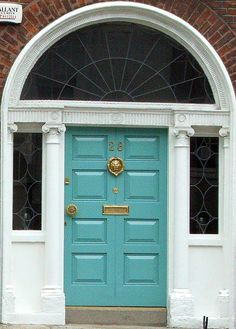 aqua front door on a traditional brick facade Aqua Front Doors, Aqua Door, Turquoise Door, Front Door Colors, Entrance Doors, Main Entrance, Brick Facade, Painted Doors, Door Knockers