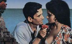 Massimo Troisi and Maria Grazia Cucinotta as Mario and Beatrice in il Postino