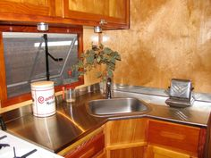 The cabinetry was refurbished to its former glory. New stainles-steel countertops and sink keep the retro look in tack.
