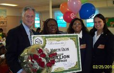 Image of a PCH winner receiving her prize.