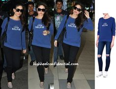 After attending the Polo event, Kareena changed into more comfortable gear before hopping on the flight back to Mumbai. Pairing her Selfridges 'Respect Your Selfie' sweatshirt with black denims and suede Tod's loafers, she does 'dressed-down' well. Left, Centre: Kareena Kapoor Photographed At Mumbai Airport Far Right: Selfridges Sweatshirt- Buy Photo Credit: Viral Bhayani More …