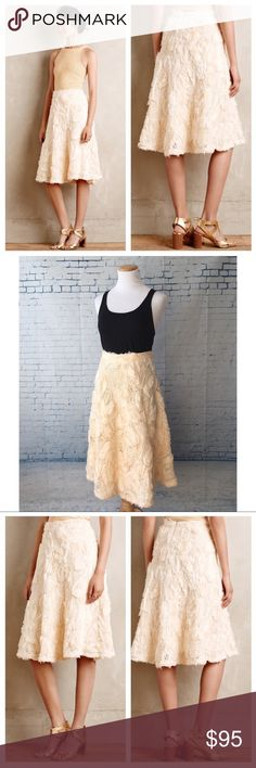 """HD in Paris Tufted Blossom Midi Skirt -A-line silhouette  -Dimensional floral appliqué  -Zips in back with a hook-and-eye closure  -Self: 100% polyester -Lining: Super soft and comfortable blend of 95% rayon and 5% spandex  Waist: 15"""" across when laid flat Length: 28"""" approx.   Amazing quality and excellent condition. Beautiful for spring and summer months. Wear with a basic top for effortless chic outfit. Add a blue jean jacket to dress it down! Anthropologie Skirts Midi"""