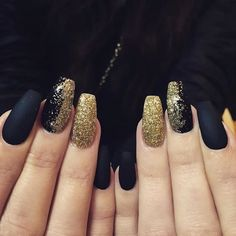 Black and glitter gold nail design