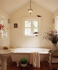 I could totally do this in my bathroom and I could live in this room.....the 2 colors used of the white and cream..to die for