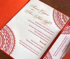 Neha, our letterpress wedding invitation, is a perfect showcase for bright tangerine and red inks.