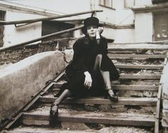 SERGEI BORISOV (*1947)  NATALY ON THE STAIRS, 1994 VERSO: SIGNED, TITLED AND DATED VINTAGE GELATIN-SILVER PRINT ON BARYTA PAPER 49,9 X 59,5 CM