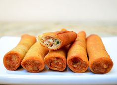 spring rolls filled with ground chicken and chopped water chestnuts, green onions and carrots...fried to golden perfection...these are seriously addicting you can't stop at one! find the recipe at http://www.kawalingpinoy.com/2013/03/lumpia-shanghai-meat-filled-spring-rolls/