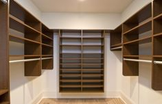 "I love the symmetry of this closet as well as the shelves all along the back wall. While I like having ""short"" shelves so that the stacks don't topple, these look like they're designed for folded men's dress shirts and are a bit too short for me."