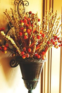 Autumn decor - love that this is wall-mounted. Could change flowers for the seasons.