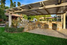 A covered outdoor kitchen with a wraparound BBQ ensures that in the summertime, entertaining is easy.