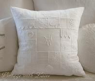 Patchwork Pillow made with old linens, random lace pieces and salvaged embroidery in white.