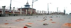 A road filled with stones as Srinagar remained under curfew on Friday.  Excelsior / Shakeel