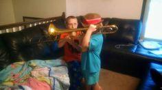 Bub helping sis on trombone