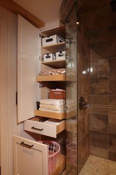 I like the idea of a pullout drawer at the bottom of our linen closet for a hamper Country Oasis - traditional - bathroom - minneapolis - Sawhill - Custom Kitchens & Design, Inc. Built in cabinet at the end of the shower/tub? Bathroom Storage Solutions, Small Bathroom Storage, Bathroom Closet, Laundry In Bathroom, Basement Bathroom, Organized Bathroom, Small Bathrooms, Small Storage, Towel Storage