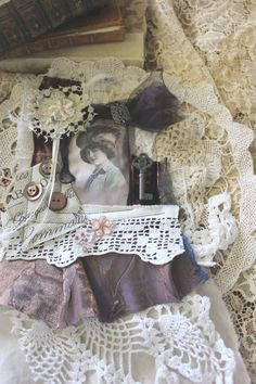 A vintage lace Parisian fabric collage by SocratesArtWorks on Etsy