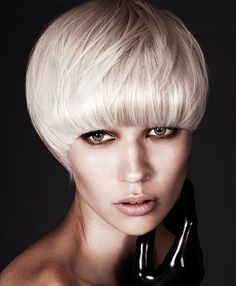 A short blonde straight coloured platinum white bob hairstyle by McIntyres