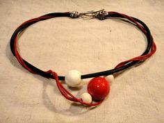 One-of-a-kind handmade red, black and white ceramics and leather necklace // Handmade necklace // Ceramic necklace  EUR 30.  Click to see more now!   // handmade jewelry // handmade jewellery // ceramic jewelry // ceramic jewellery
