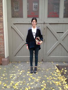 So cute, Man Repeller! Like the outfit and the barn doors. Tshirt Sandro, sweater Alexander Wang, green jeans J Brand, booties Chanel, purse Antik Batik.