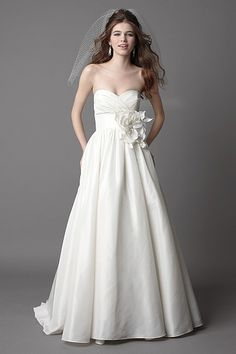 Wtoo Brides Mimi Gown   Ivory Silky Taffeta strapless gown with pleated bodice, empire band, bead embellished flower and full shirred skirt. Chapel train.