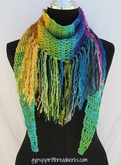 """Release your inner rebel rocker in this wildly fringed long triangular crocheted scarf...stay warm and be cool at the same time. No two Wild Child scarves will ever be the same. Scarf measures 64"""" lon"""