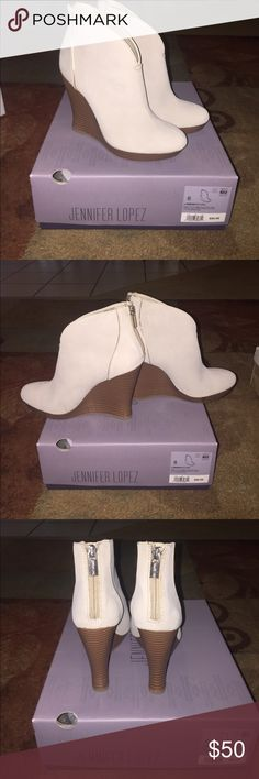 Brand new Jennifer Lopez wedge booties Brand new Jennifer Lopez wedge booties. I would describe the color to be a light taupe with a brown wedge. Jennifer Lopez Shoes Ankle Boots & Booties