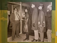 Assistant manager Israel Batista-Olivieri blocks the entrance as Morgan State College students, from left, Latifah Lois Chinnery, Marvin Redd, and Richard E. Timmons attempt to buy tickets at the Northwood.  Photo credit: William L. LaForce, Jr. / National Building Museum