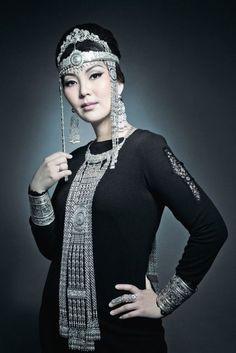Beautiful parure of Yakutian jewelry on a beautiful Yakut lady.