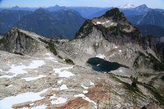 Vesper Lake beneath Sperry Peak, as seen from above. Photo credit: Paul Kriloff.
