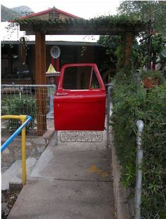 A-door-able!! Car door as a gate. Bet this would look great in a man cave as a bar door.