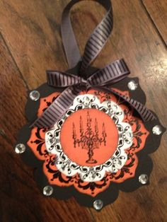 handmade ornament ... Halloween Daydream Medallions Ornament by binkiemonstermom ... luv the candelabra on the center circle ...