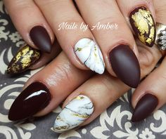 burgundy and gold marble nail design