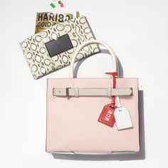 RK40 handbag in white, nude, and grey with Atlantique Clutch in black and white.