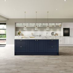 Fairford Navy and Fairford Dove Grey Create a country style kitchen with a navy kitchen island and grey kitchen back units. Two-tone kitchens are on-trend and can be used to create a modern or traditional kitchen. Grey Kitchen Interior, Navy Kitchen, Open Plan Kitchen Living Room, Modern Shaker Kitchen, Modern Country Kitchens, Two Tone Kitchen, Modern Country Style, Shaker Style Kitchens, Kitchen Country