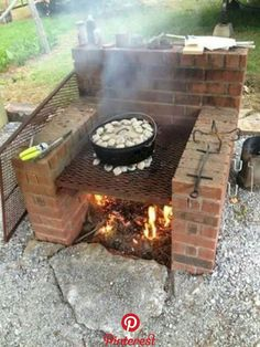 60 Easy DIY Fire Pit Plans & Ideas to Make Happy with Your Family A fire pit makes for a wonderful gathering place with family and friends, and installing one is a simple DIY project. A DIY fire pit . Outdoor Grill, Outdoor Cooking, Patio Grill, Bbq Grill, Diy Fire Pit, Fire Pit Backyard, Backyard Patio, Brick Grill, Fire Pit Plans
