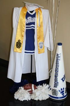 Display high school cheerleading uniform and cap/gown from graduation. Love this, it turned out great!!