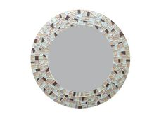This simply stunning mosaic mirror from Green Street Mosaics features mosaic tiles in metallic silver, gold, and bronze. The color palette is