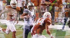 Taysom Hill hurdles a Texas defender and runs into the endzone to start the route of Texas 41-7.