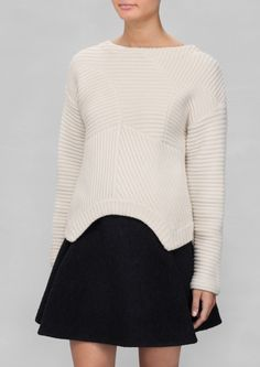 & Other Stories | Lamb Wool Sweater. Warm and cozy, this lamb wool blended sweater features an intriguingly shaped hem and an overall rib-knit texture.