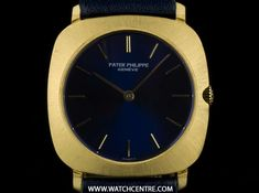 patek philippe yellow gold blue dial cushion case vintage gents 3543 An Yellow Gold Cushion Case Vintage Gents Wristwatch, blue dial with applied index batons, a fixed yellow gold brushed bezel, a dark blue leat - Watchcentre Gold Cushions, Bond Street, Patek Philippe, Black Opal, Yellow, Blue, Clock, Glass, Nautilus