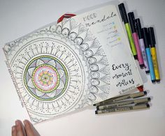 "This is my mood mandala (you can see @bujo.mama instagram if you don't know what it is)… I'm giving it a try this month … To explain it easy, each ""ring"" of the mandala shows how you felt that day, like a mood tracker"