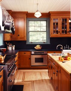Shaker Cherry Kitchen Black Backsplash and counter with contrasting island.
