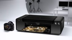 """Canon Pixma Pro-1 Printer - This printer is the cream of the crop when it comes to inkjet printing at home. It's the best desktop printer Canon sells and it's meant for the ultimate professional. It has 12, count'em 12, ink cartridges and it can produce the most amazing color accurate photos up to 13""""x19""""."""
