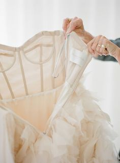 The right before you step into it: http://www.stylemepretty.com/2016/05/11/wedding-dress-photos-bride/