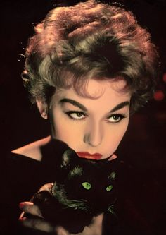 Kim Novak and her Siamese familiar, Pyewacket from Bell, Book, and Candle (1958)