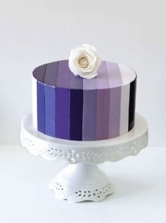 Purple and Blue Hued Striped Cake Topped with White Rose