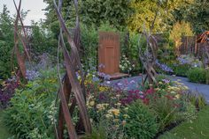 Hampton Court Flower Show2018. By garden designer Charlie Bloom. Brilliance in Bloom was conceived as a garden for craftspeople in small organisations, to showcase their skills & dedication on a massive stage, shoulder to shoulder with giants of the industry.
