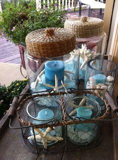 Blauwe kaarsen met zand en schelpen