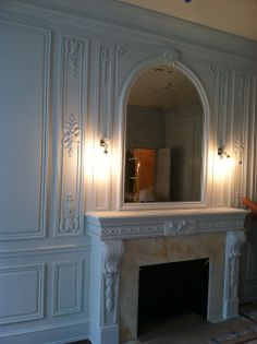 Installation of hand carved boiserie living room in NYC. Hand carved, designed and manufactured by Auffrance.